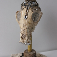 Fox Skull, Victorian era dress remnants, antique jewels, relics from Salzburg's castle, quartz crystal, antique rosary beads, antique lace, mixed media